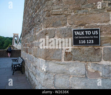 Bristol, UK - June 28th 2019: A sign with the Samaritans phone number - hoping to influence potential suicide victims to ring for help, on Clifton Sus - Stock Photo