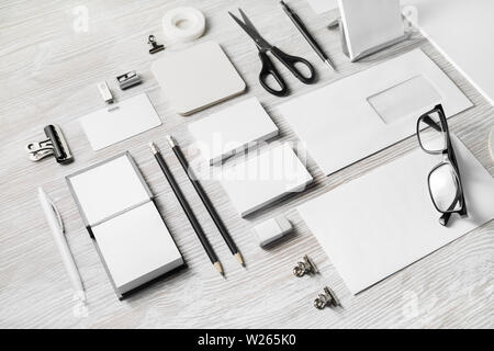 Blank corporate stationery set on light wood table background. Branding mock up. Template for placing your design. - Stock Photo