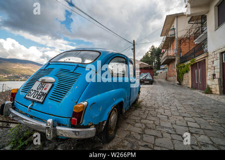 Ohrid, Northern Macedonia -  April 2019 : Blue mini beetle car parked on a cobblestoned street in Ohrid Old Town - Stock Photo