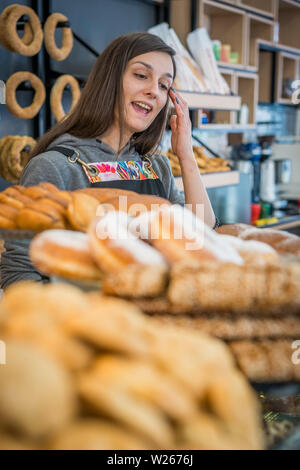 Zakynthos, Greece -  April 2019 : Young pretty girl selling bakery products in bakery - Stock Photo