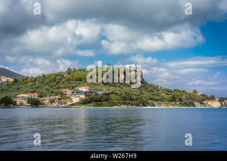 Zakynthos, Greece -  April 2019 : Hotels on the hills near Keri beach as seen from the sea, Zante Island, Ionian islands - Stock Photo