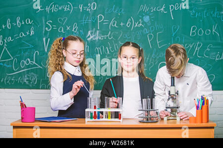 Chemistry equipment. students doing biology experiments with microscope in lab. Little kids learning chemistry in laboratory. Chemistry education. Happy children. Chemistry lesson. I love my job. - Stock Photo
