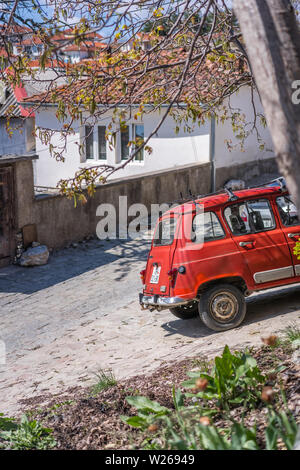 Ohrid, Northern Macedonia -  April 2019 : Small old car parked on a cobblestoned street in Ohrid Old Town - Stock Photo