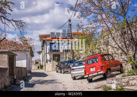 Ohrid, Northern Macedonia -  April 2019 : Small old cars parked on a cobblestoned street in Ohrid Old Town - Stock Photo