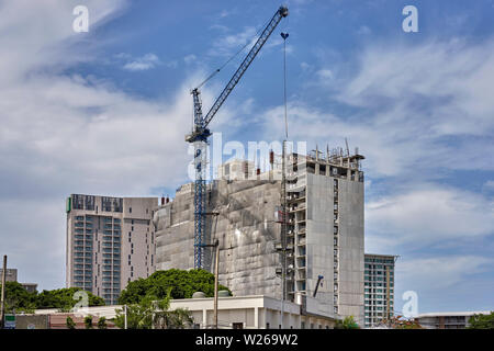 New high rise hotel under construction in Pattaya Thailand Southeast Asia - Stock Photo