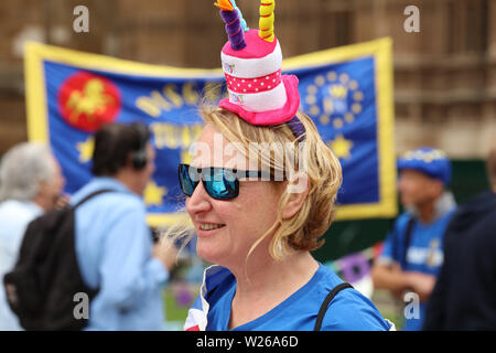 Colourful dressed stop Brexit campaigner in the front of the Houses of Parliament, London, UK - Stock Photo