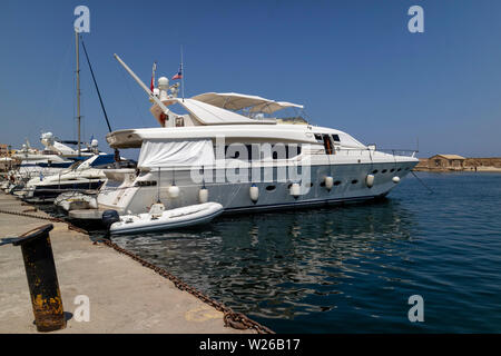 Chania, Crete, Greece, June 2019. Luxury motor cruiser berthed on the Old Venetian Harbour in Chania, Crete - Stock Photo
