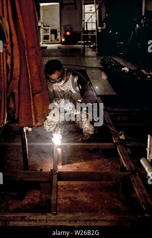 Welder arc welding - Stock Photo
