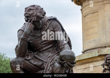 Hamlet with the skull of the jester Yorick at the Gower Memorial in Stratford Upon Avon - Stock Photo