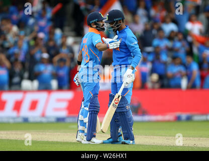 India's KL Rahul celebrates his century with Virat Kohli during the ICC Cricket World Cup group stage match at Headingley, Leeds. - Stock Photo