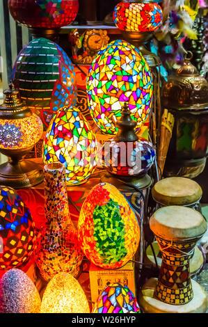 Colorful scattered-mosaic lamps on display with oriental tablas ( drums, darbula), in El Muez (Muizz, Moez) Street in Khan El Khalili, Al Shaaban Baza - Stock Photo