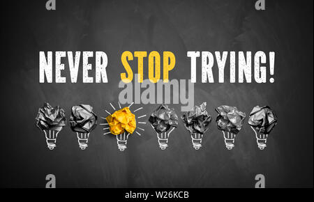 chalkboard with the message 'never stop trying' - Stock Photo