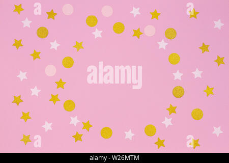 Festive pink background. Colorful confetti and golden stars on light pink background. Top view - Stock Photo