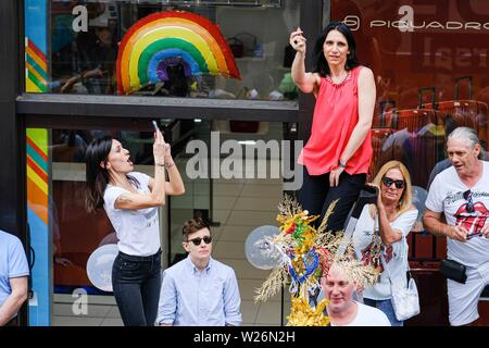 London, UK. 6th July 2019. People dance and have fun as the Pride In London Parade passes them in Regent Street on Saturday, Jul. 6, 2019. Picture by Julie Edwards Credit: Julie Edwards/Alamy Live News - Stock Photo