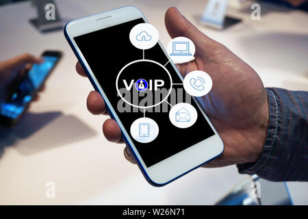 Man using mobile phone and concept communication call center with virtual reality icon diagram. - Stock Photo