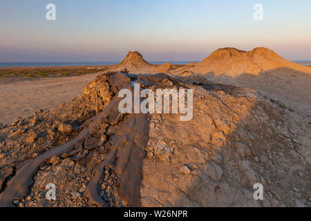 Mud volcanoes in Gobustan at sunset - Stock Photo