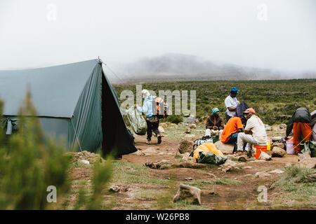 Lunchtime at Shira 1 Camp on the way to the top of Mount Kilimanjaro in Tanzania - Stock Photo
