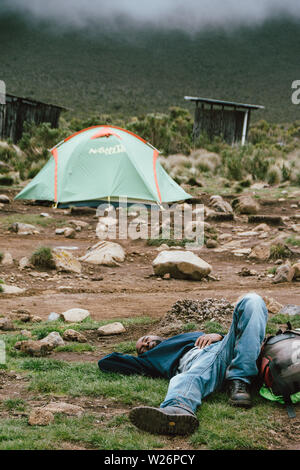 Having a rest on the way to the top of Mount Kilimanjaro in Tanzania - Stock Photo