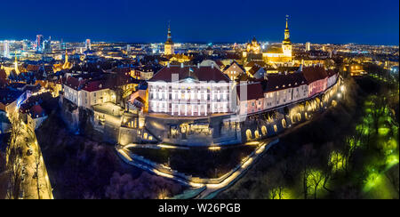 Aerial night panorama Tallinn medieval old town, Toompea Hill with Estonian government building in the center and modern city center in the background - Stock Photo