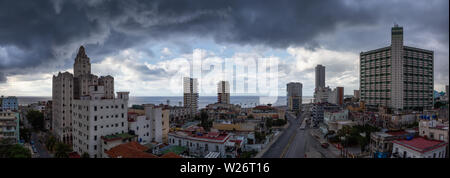 Aerial Panoramic view of the Havana City, Capital of Cuba, during a dramatic and storm cloudy day. - Stock Photo