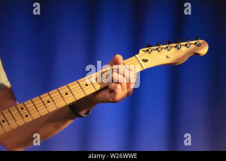 Male hands playing on electric guitar, close up . - Stock Photo