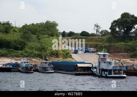 Embark and Disembarkation of Gas, Amazônia, Manaus, Amazonas, Brazil - Stock Photo