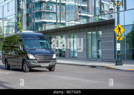 Compact commercial transportation economical, convenient minivan for small business or local transportation and delivery of goods moving along the str - Stock Photo