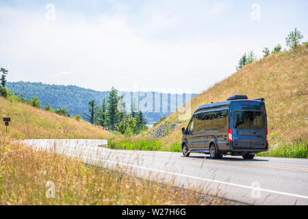 Compact luxury commercial transportation economical, convenient minivan for small business or local moving and delivery of goods running on the windin - Stock Photo