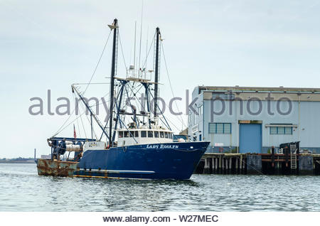 New Bedford, Massachusetts, USA - July 4, 2019: Commercial fishing vessel Lady Roslyn, hailing port Cape May, New Jersey, passing State Pier in New Be - Stock Photo