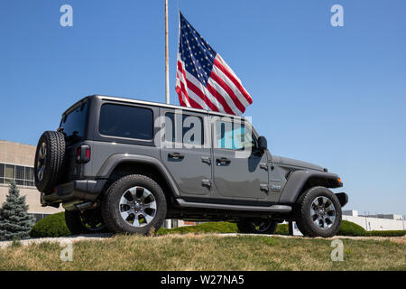 Kokomo - Circa July 2019: Jeep Wrangler on display at a Chrysler plant. The subsidiaries of FCA are Chrysler, Dodge, Jeep, and Ram VII - Stock Photo