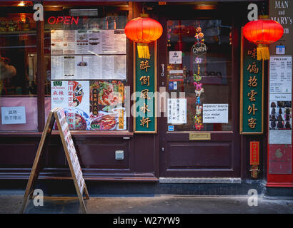 London, UK - April, 2019. A Chinese restaurant decorated with red lanterns in Chinatown, in Soho district. - Stock Photo