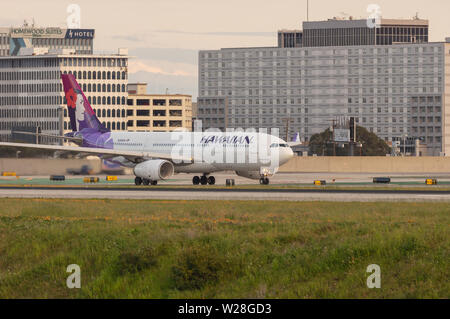 Los Angeles, CA/USA,  March 10, 2019: image showing a Hawaiian Airlines Airbus A330 (registration number N384HA)  at take off. - Stock Photo