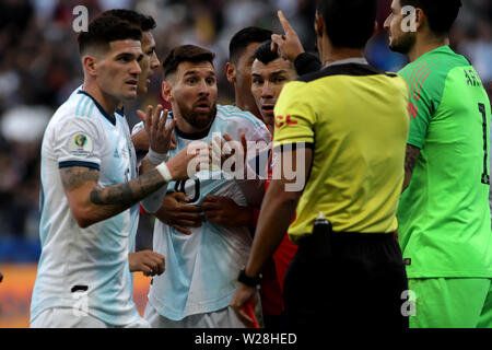 Sao Paulo, Brazil. 6th July, 2019. Argentina's Lionel Messi (3rd L) reacts after he recieved a red card during the 3rd place match of Copa America 2019 between Argentina and Chile in Sao Paulo, Brazil, July 6, 2019. Credit: Rahel Patrasso/Xinhua/Alamy Live News - Stock Photo