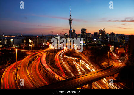 Motorways, Lightpath cycleway, and Sky Tower, Auckland, North Island, New Zealand - Stock Photo