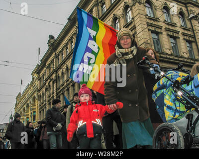 Helsinki, Finland - March 22, 2003: Anti-war protesters march through downtown Helsinki to protest the impending United States invasion of Iraq. - Stock Photo