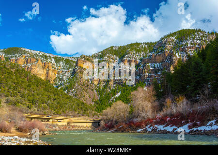 Glenwood Canyon, Colorado with the Colorado River and I-70 in the Background on a Sunny Day - Stock Photo