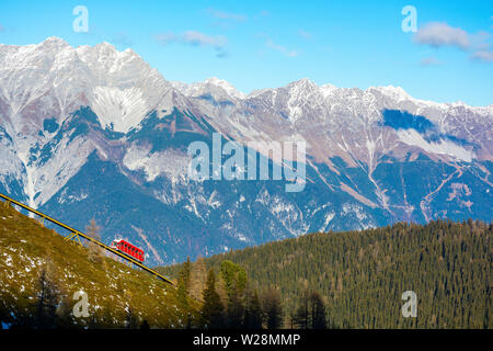 Funicular Tram in the Mountains on a Sunny Day - Stock Photo