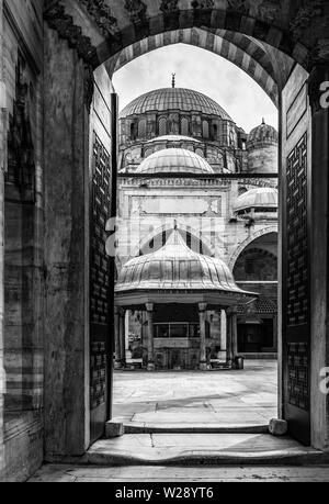 Black and white view of Sehzade Mosque courtyard from the entrance door, Istanbul, Turkey - Stock Photo