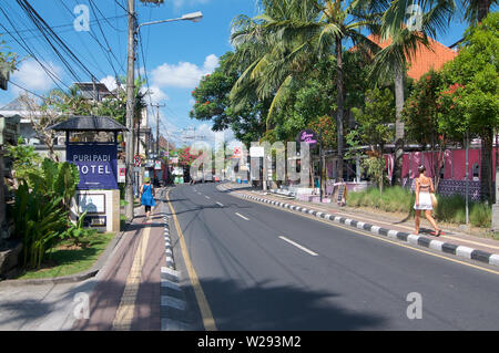 Ubud, Bali, Indonesia - 17th May 2019 : View on the Jalan Raya Pengosekan road, one of the most busy streets in Ubud, Bali - Indonesia - Stock Photo