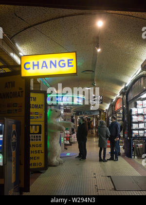 In a covered pedestrian passage at the Charles bridge,Karlův most, in Prague Czech Republic there is a money exchange and souvenirs till late at night - Stock Photo