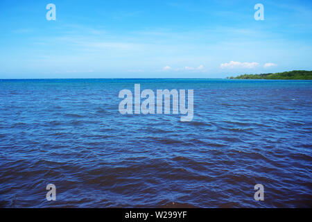 Horizon Line Between Blue Sea Water and Blue Sky - Stock Photo