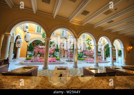 Spring floral display at the Bellagio Casino and Resort conservatory garden. The garden features seasonal floral displays that change with the season - Stock Photo