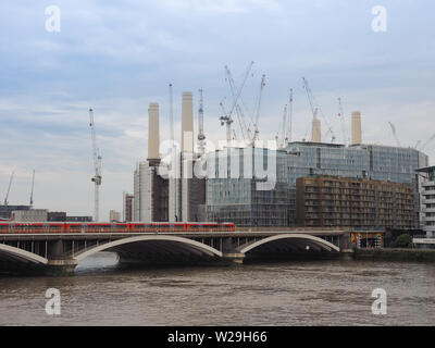 LONDON, UK - CIRCA JUNE 2019: Panoramic view of River Thames with Battersea Power Station and Victoria Bridge seen from Chelsea Bridge - Stock Photo