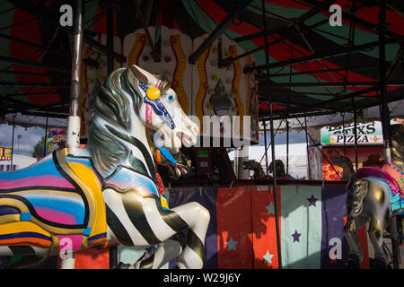 Cheboygan, Michigan, USA - August 9, 2018: Close up of colorful carousel horse on the merry go round at the Cheboygan County Fair - Stock Photo