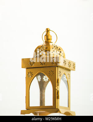Traditional fanoos or an Arabic decorative lantern on white background. Eid celebration objects and background. - Stock Photo
