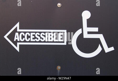 Handicapped Accessible Sign. Close up of handicapped accessible sign. - Stock Photo