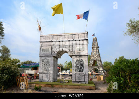 Wooden Models of Arc de Triomphe Paris & Eiffel Tower Built of Pallets during Gilets Jaunes Demonstrations, or Yellow Vests Movement, 2018-19  France - Stock Photo