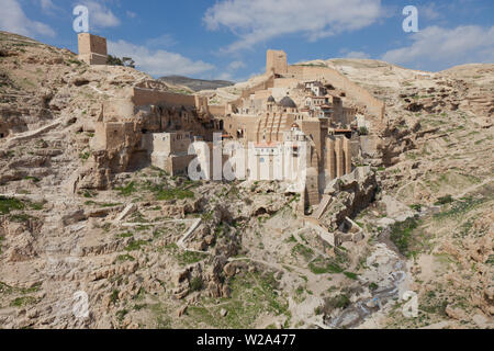 Panoramic aerial wide angle landscape of Holy Lavra of Saint Sabbas the Sanctified, known in Arabic as Mar Saba in the Judean desert in Israel. West B - Stock Photo