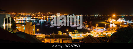 Panoramic night picture of Mindelo city in twilight. Port town with many boats in the lagoon on the Cape Verde, Sao Vicente Island - Stock Photo