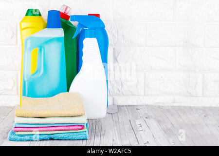 Cleaning tools - liquid, paste, gel in a plastic containers. Brush, sponge, microfiber napkin - Stock Photo